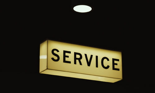 A yellow box with the word service in black letters on the middle of black background